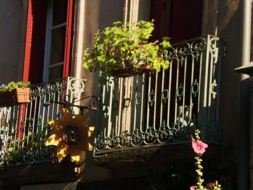 Cordes shutters and metal railing on balcony FAV